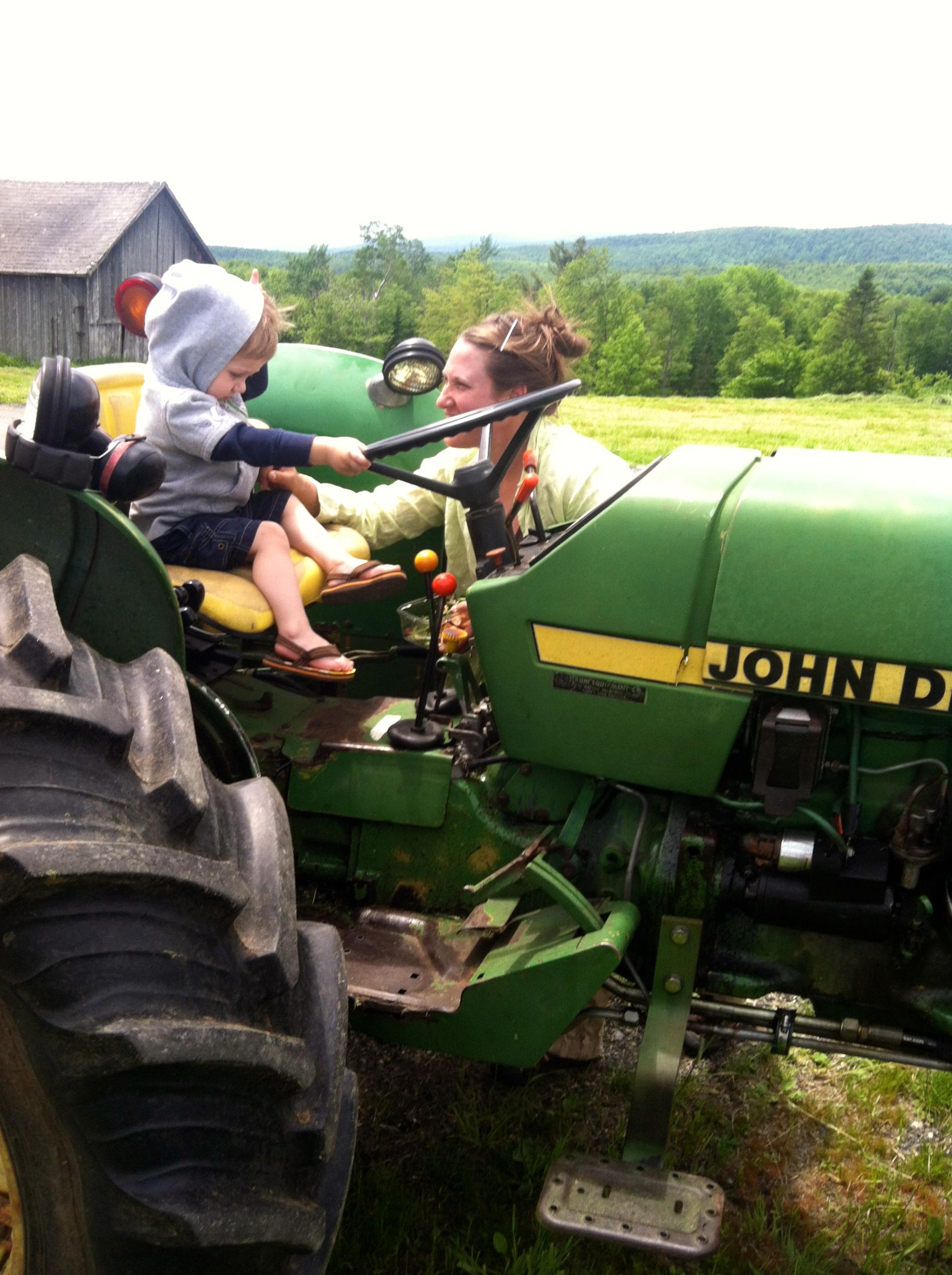 Corse Family Farm - Eli on the tractor