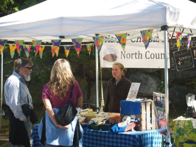 North Country Creamery - talking with customers at the market