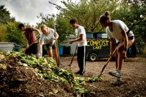 Students at Pomona College mixing compost.