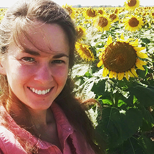 Hannah with sunflowers_crop