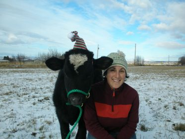 Laura celebrating Christmas with the cows
